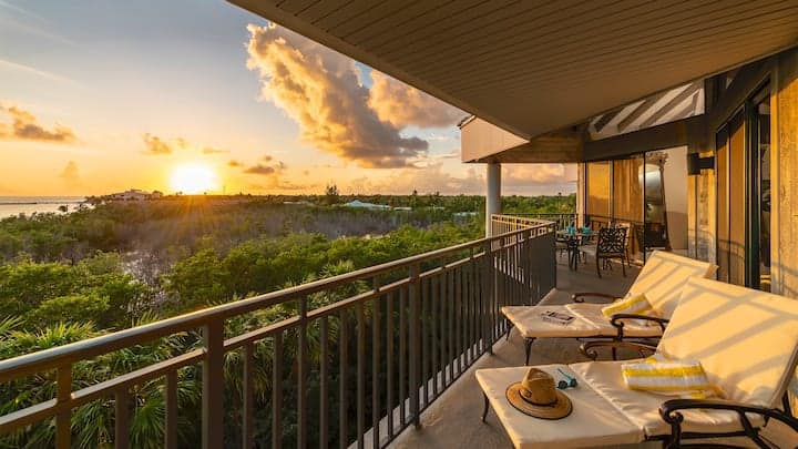 Airbnb in Key West balcony overlooking ocean at sunset.