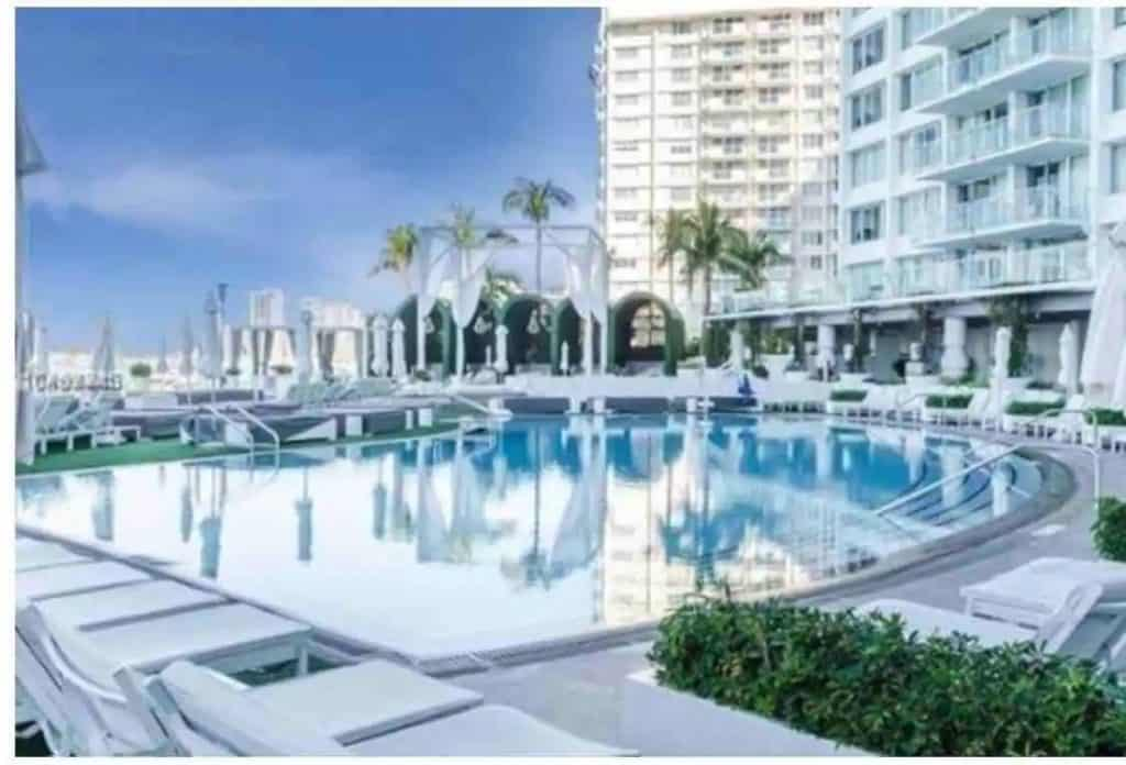Photo of luxury resort style pool at a 5 star hotel studio condo Airbnb in Miami.