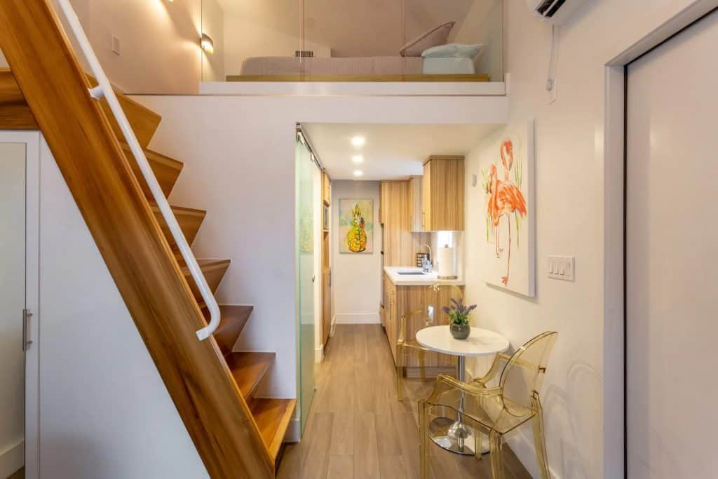 Photo of the Casa de Reg Airbnb in Miami showing the kitchen, breakfast nook, and loft.
