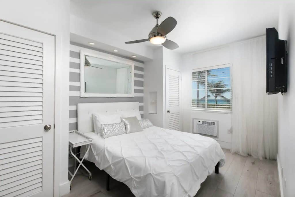 Photo of bedroom inside an epic Ocean Drive oasis Airbnb in Miami.