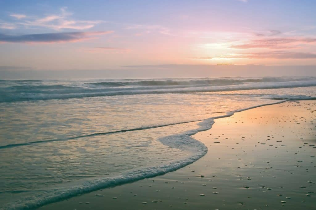 soft colorful sunrise at Canaveral National Seashore day trips from Orlando
