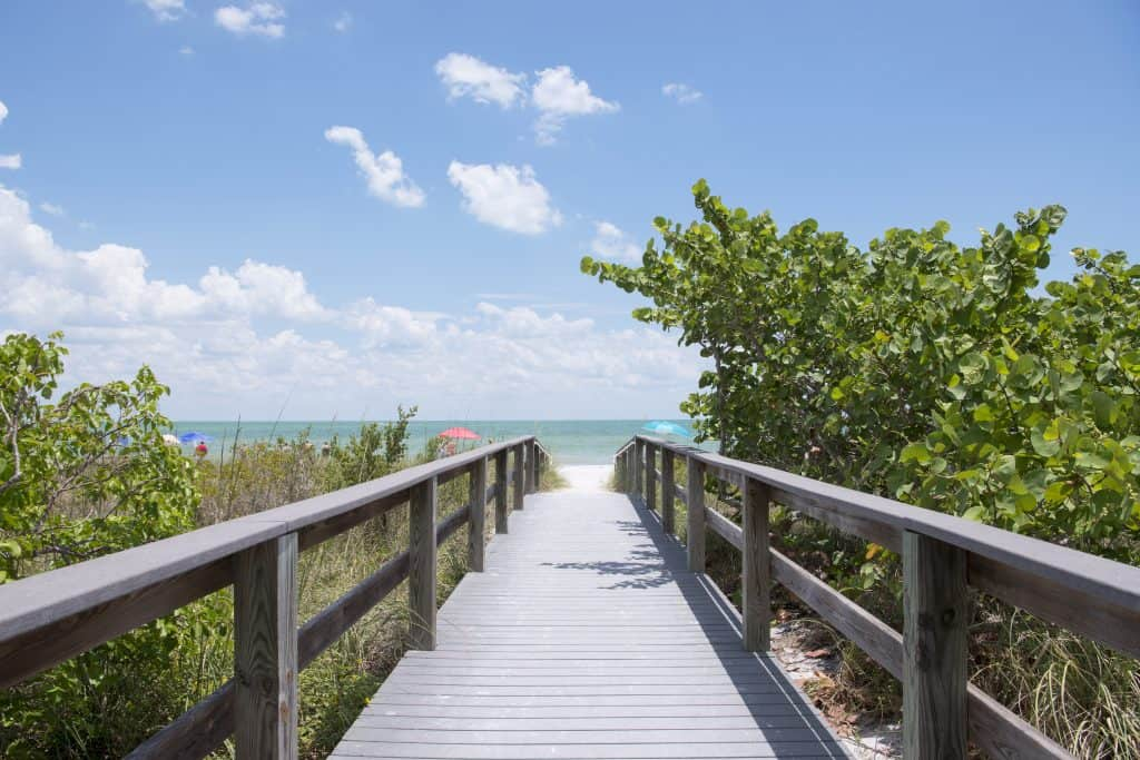 wooden walkway to beach day trips from Orlando