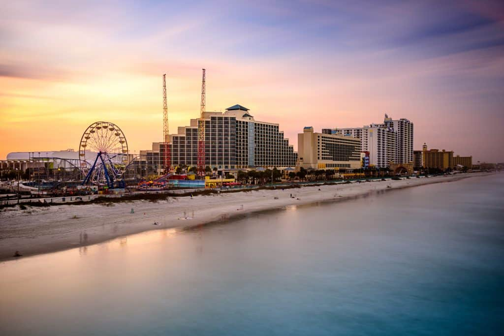sunrise over tall hotels of Daytona Beach