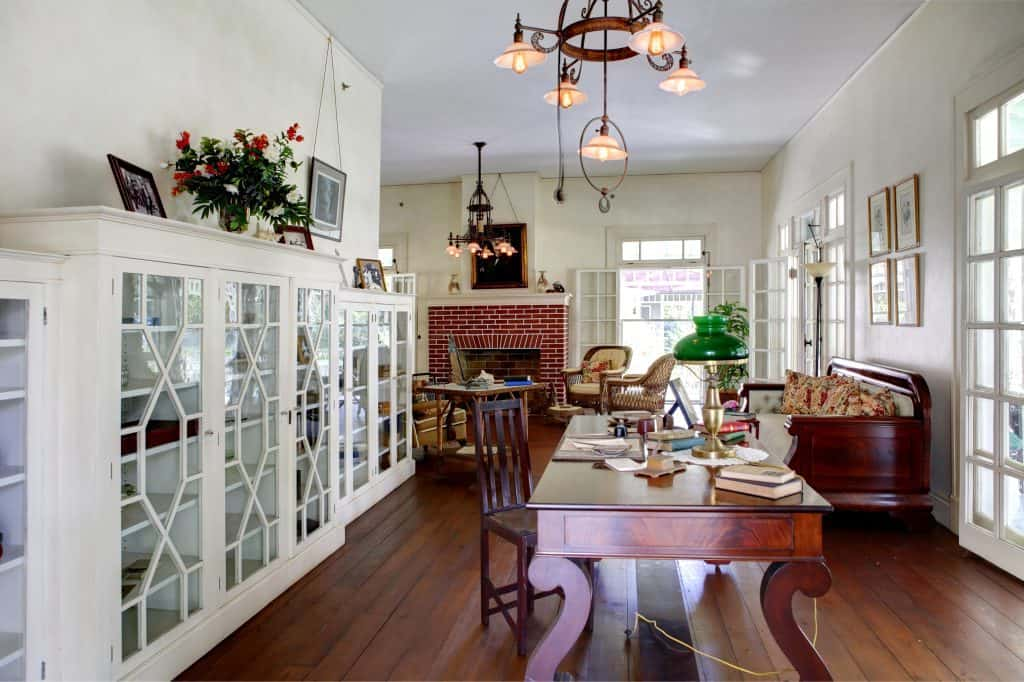 interior of historic home with work table and family room