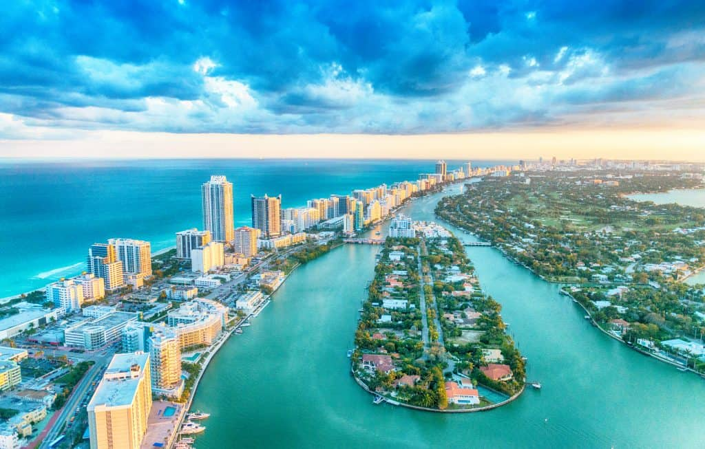 sunrise over tall buildings and blue waters of Miami
