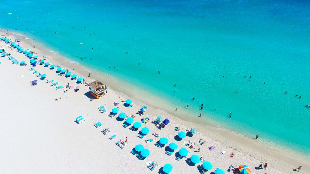 aerial views of blue umbrellas of Miami Beach day trips from Orlando
