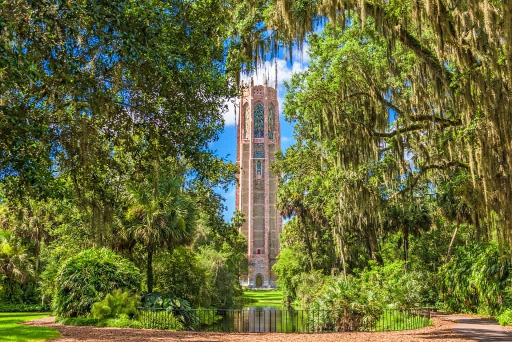 tall beige tower surrounded by greenery