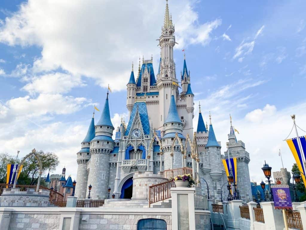 Cinderella's castle at Disney with gray and white stones and blue tops day trips from Tampa