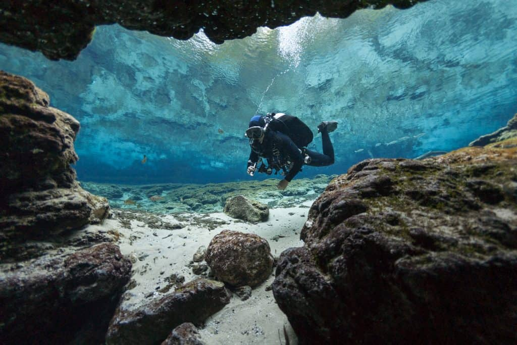 scuba diver entering underwater cave day trips from Tampa