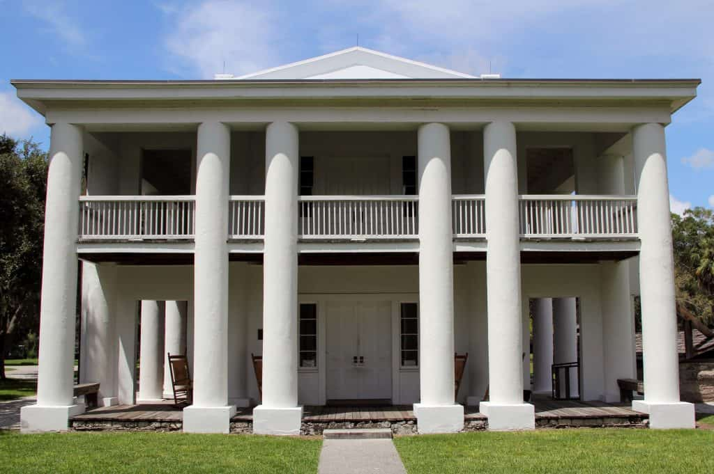 front of six-columned white plantation home