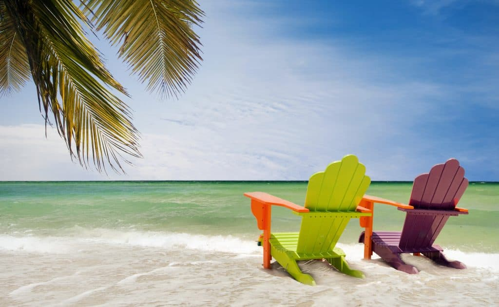 hidden gems florida colorful chairs on florida beach.