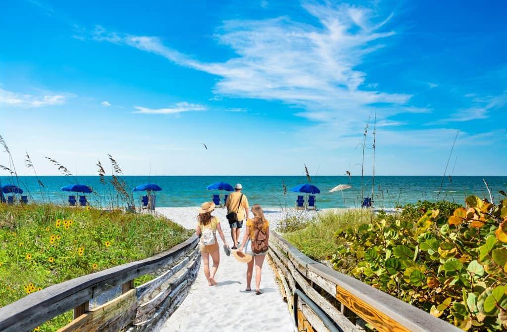 Hidden Gems Florida beachgoers walk on Caladesi Island.