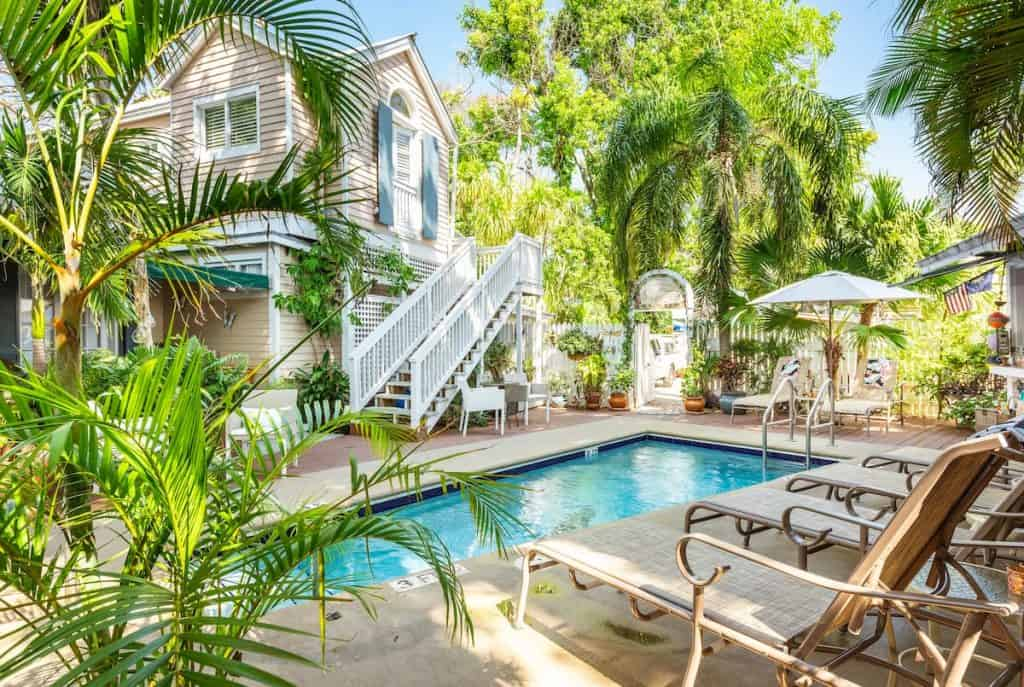 Airbnb in Key West with pool deck with palm trees