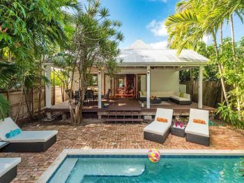 Sit poolside with recliners at shaded pool at an airbnb in key west