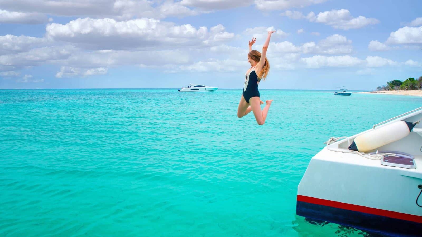 florida packing list girl jumping off boat