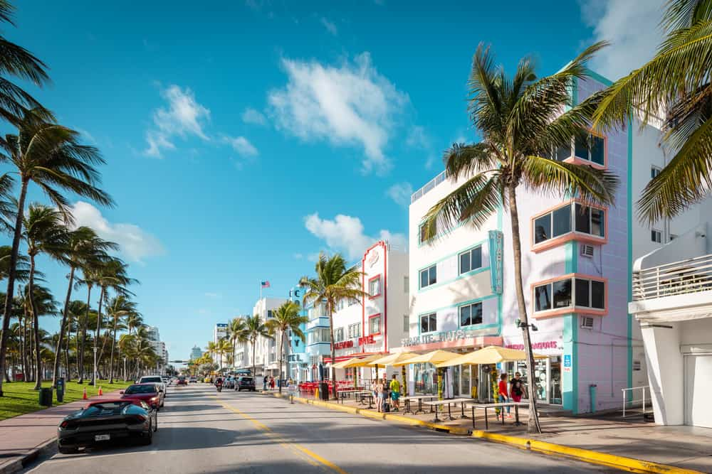 white buildings with colorful borders lining street in Miami