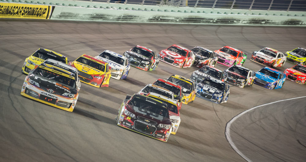 twenty cars racing around Homestead-Miami Speedway Miami to Key West drive