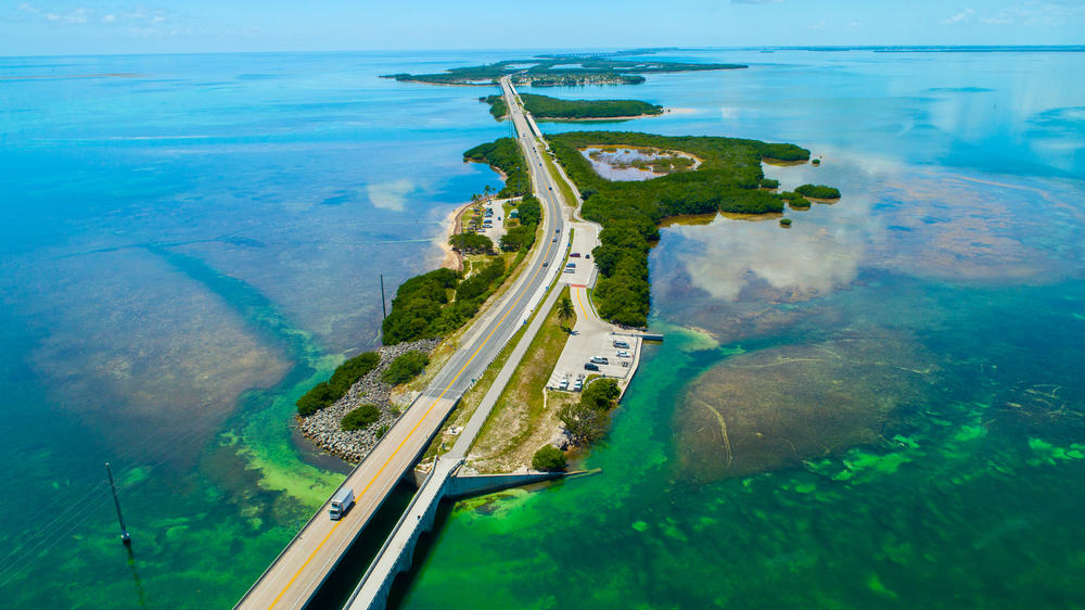 aerial view of road cutting through three of the Florida Keys