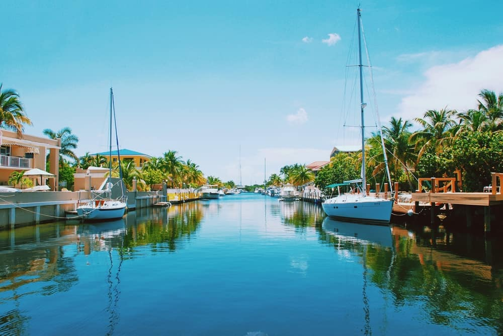 beautiful boats and houses lining waterway Miami to Key West drive