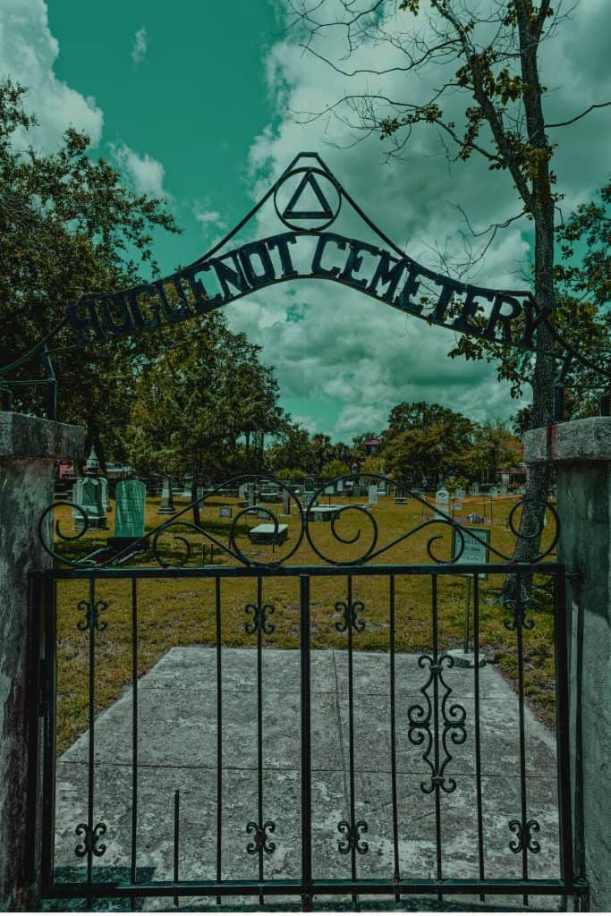 Spooky photo of the gate at Huguenot Cemetery, a stop on many Saint Augustine ghost tours.