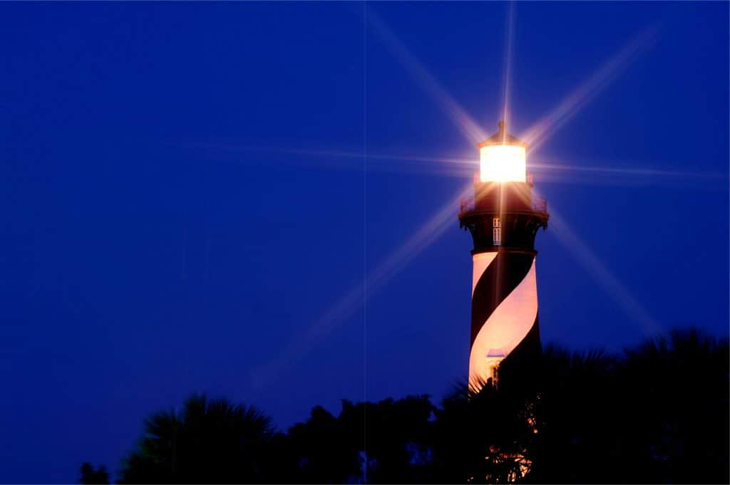 Nighttime photo of old lighthouse which can be seen on a Saint Augustine lighthouse ghost tour.