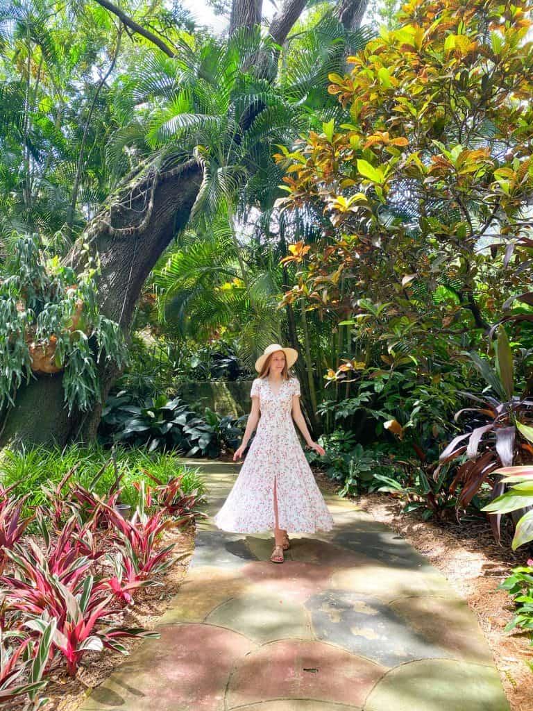 walking along a pathway at the sunken gardens in Saint Petersburg Florida