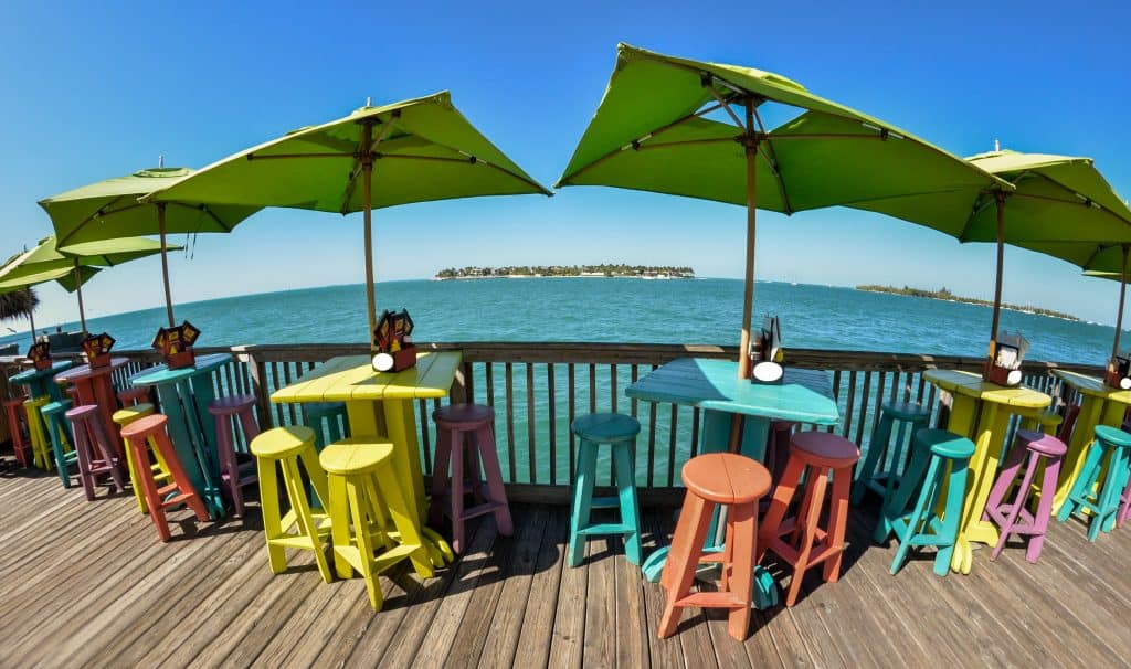 Restaurant chairs on pier near ocean best things to do in key west