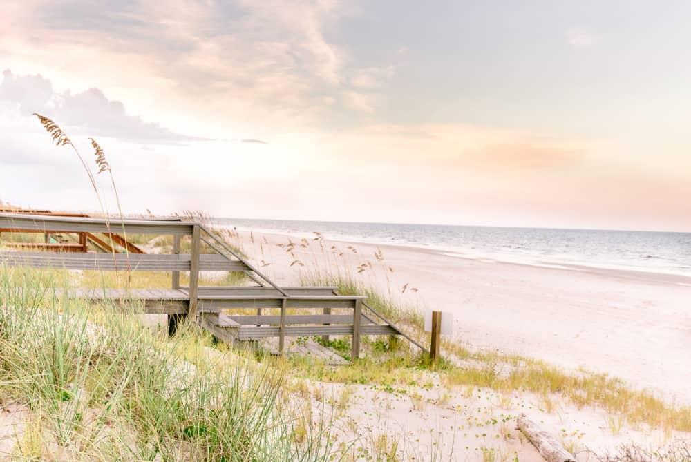 wooden steps leading bright sandy shoreline weekend getaways in Florida