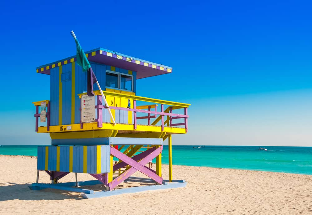 blue, yellow, and purple lifeguard booth on Miami Beach
