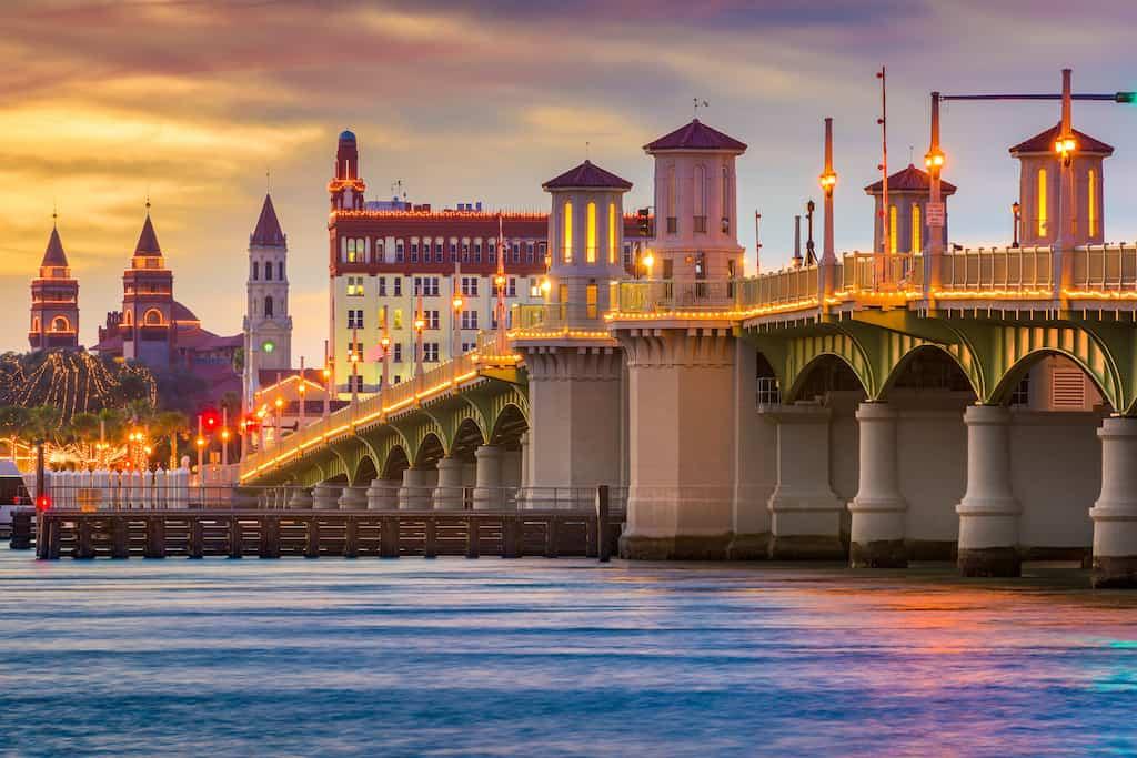 bridge across water in St. Augustine, Florida lit up at night weekend getaways in Florida