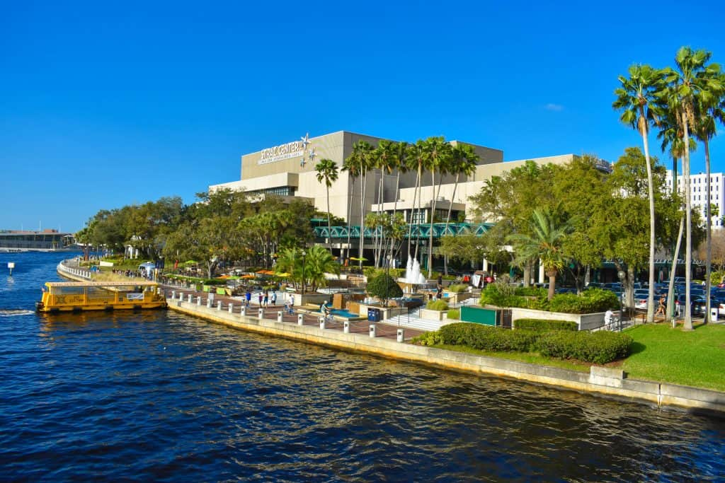 The view of the breezeway and outdoor lobby of the STRAZ Center as seen from the Hillsborough River, one of the best things to do in Tampa.