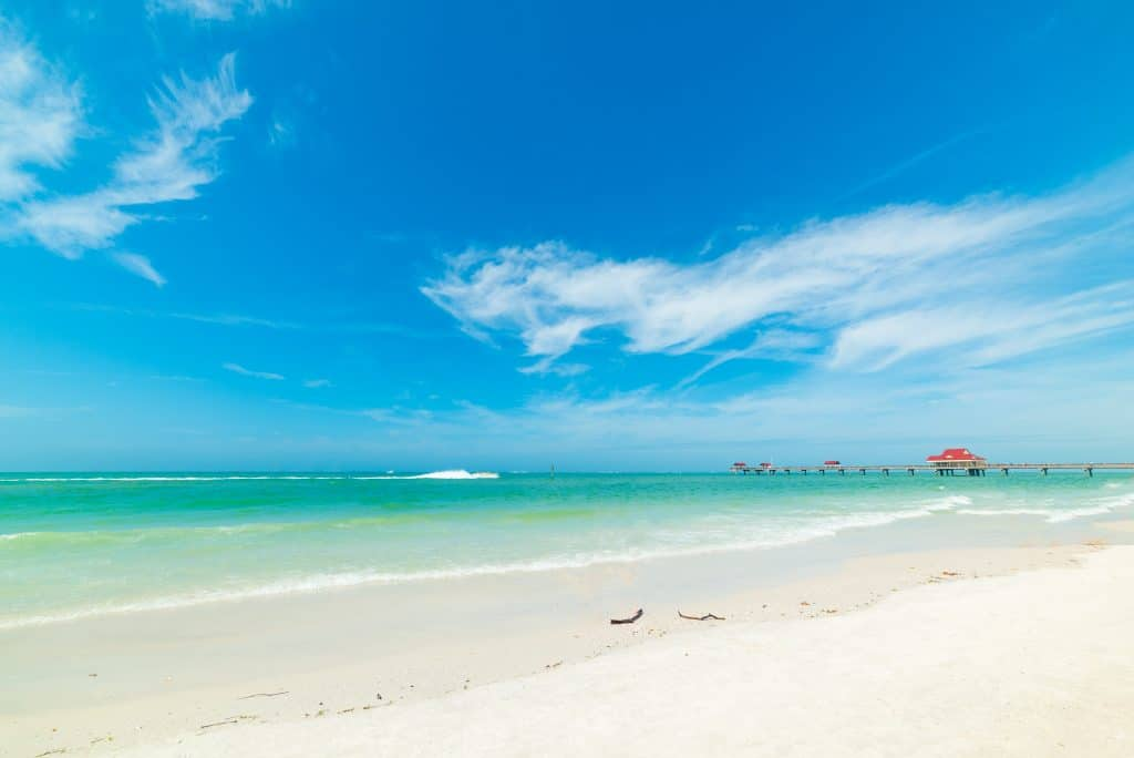 The crystal clear waters and white sands of Clearwater Beach, one of the best things to do in Tampa.