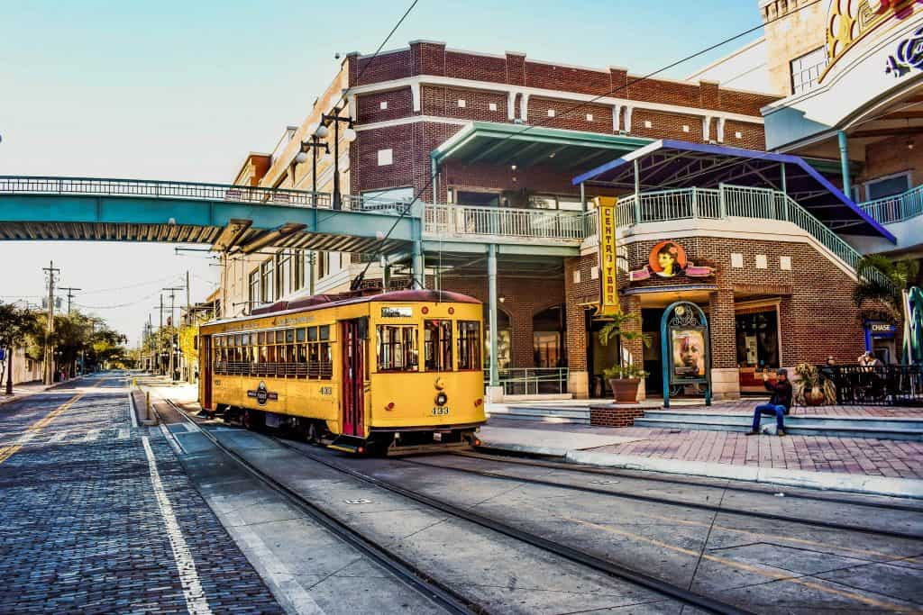 A TECO trolley passes under the pedestrian crosswalk in the Historic Ybor City District.