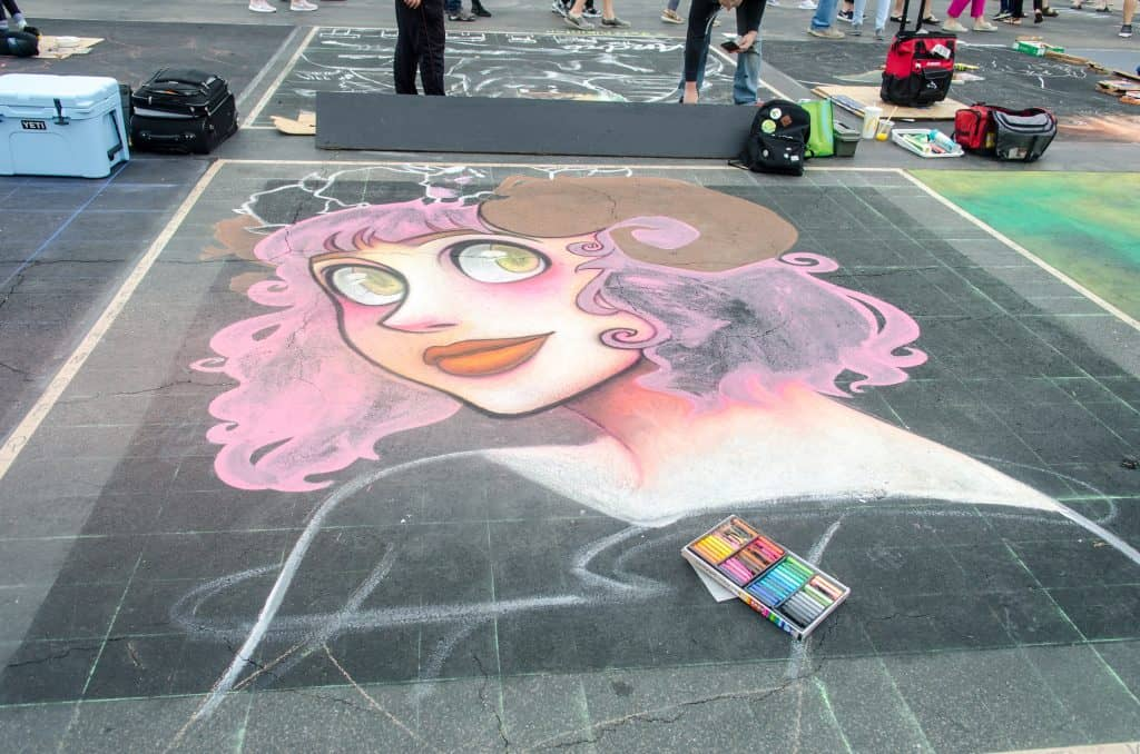 A chalking piece of a woman with pink hair at the International Chalking Festival.