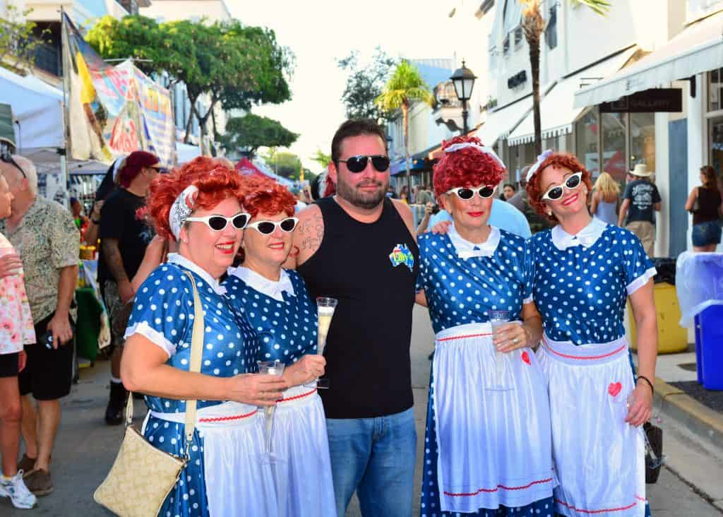 A pack of wild Lucille Balls poses with a guest at Fantasy Fest, the most inclusive of all the festivals in South Florida.