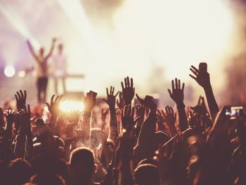 Hands are up in the air at a concert at a festival in Florida.