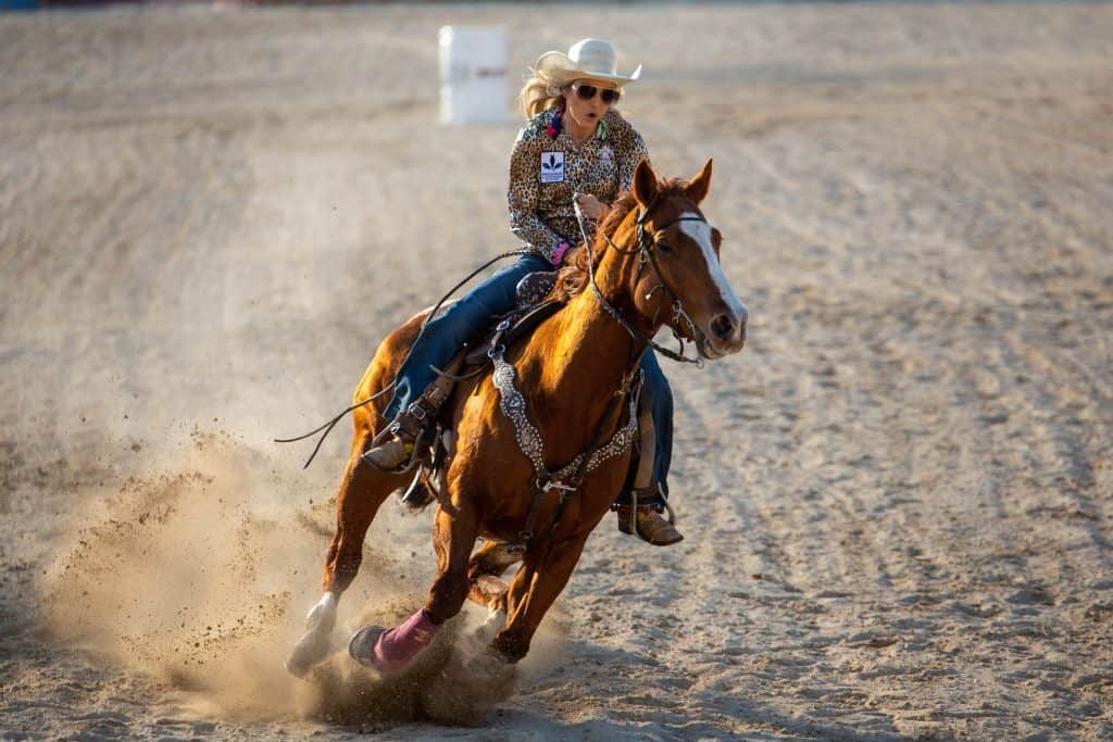 An exhibitionist rides a horse in the area at the Homestead Rodeo, one of the rowdiest festivals in Florida.
