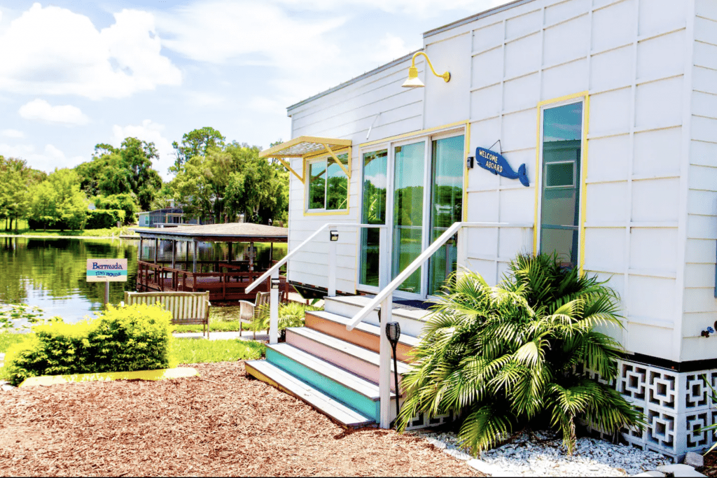 The tropical exterior of the Bermuda, a tiny home perfect for glamping!