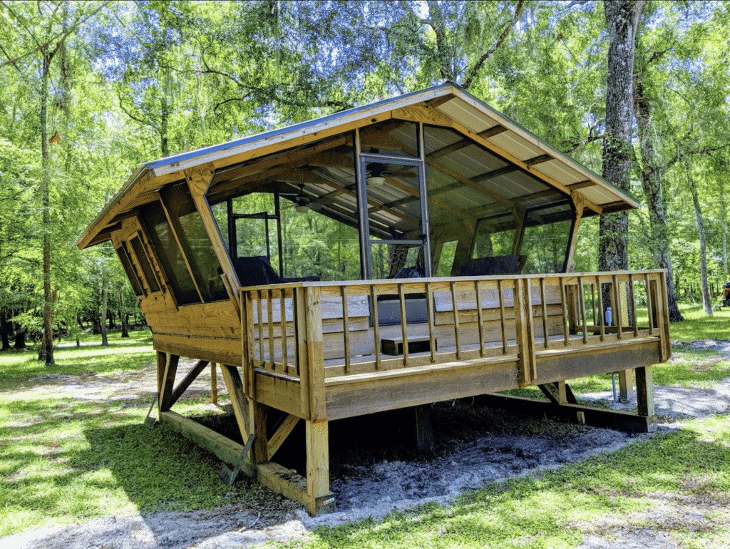 The open-air building, the birdhouse, is a perfect place for glamping in Florida.