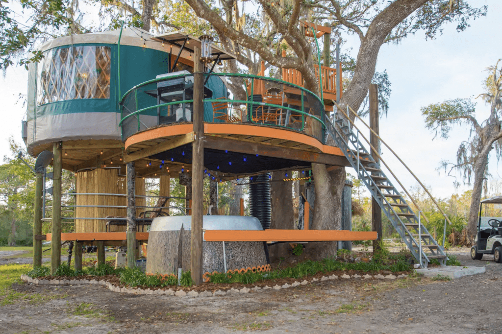 The colorful, quirky, unique Treehouse at Danville with one of the best above-ground yurts in Florida!