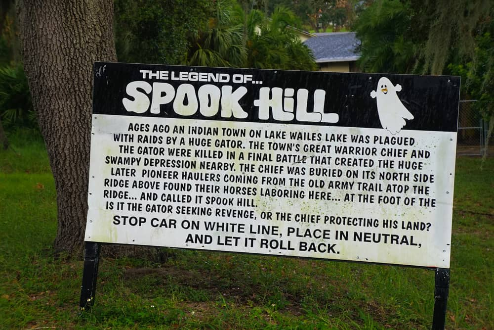 Photo of sign explaining the legend of Spook Hill, one of the most haunted places in Florida.