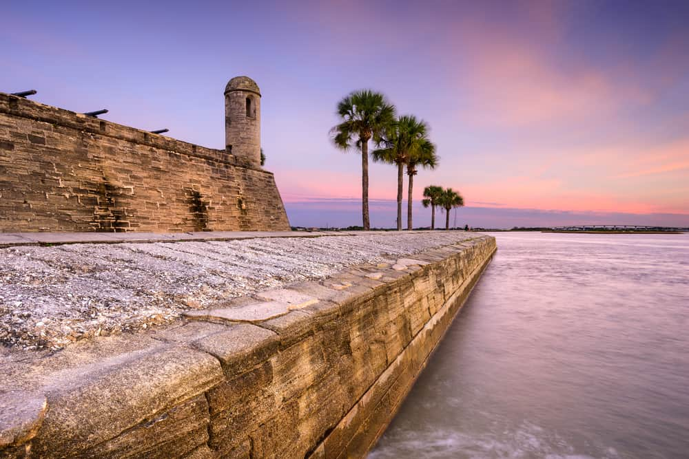 Photo of the beautiful Castillo de San Marcos National Monument in the lush pink sunset.