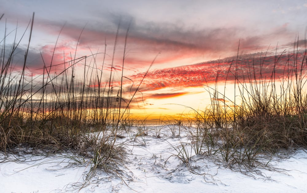 Photo of the De Soto National Monument's white sandy beach at sunset.