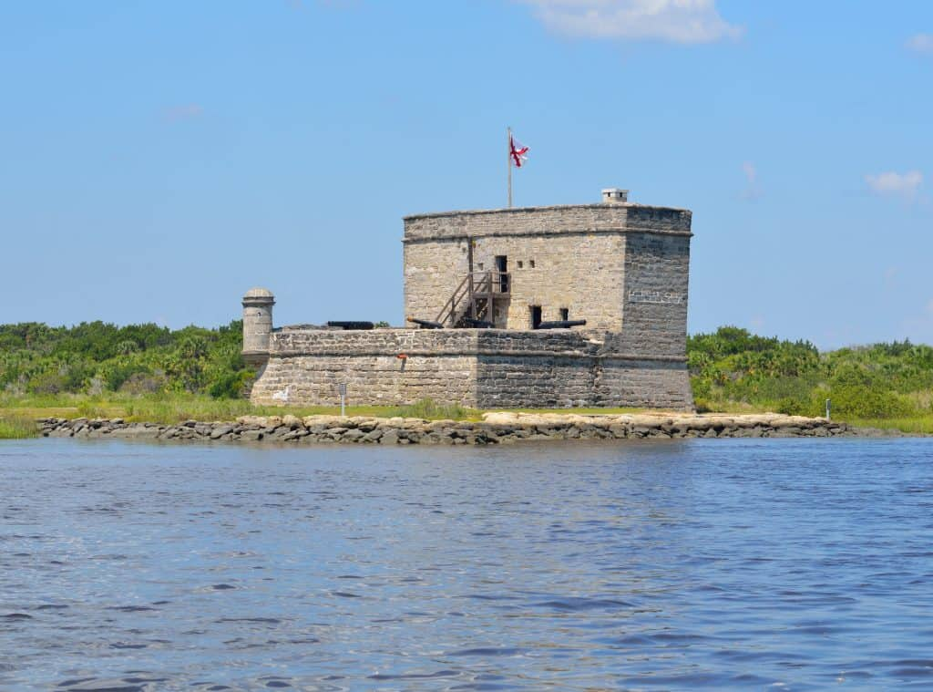 Photo of the stone structure of Fort Matanzas National Monument  surrounded by calm waters