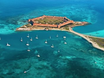 Aerial photo of Fort Jefferson surrounded by the endless blue waters of Dry Tortugas National Park, one of Florida's National Parks