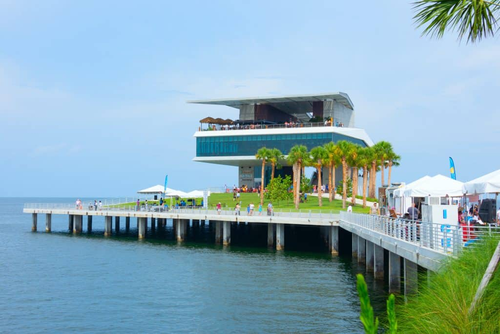 The newly renovated St. Pete pier with a fishing platform, palm trees and several restaurants