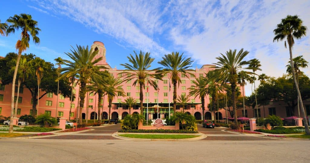 The upscale Vinoy Hotel's beautiful salmon pink exterior surrounded by palm trees in downtown st. pete