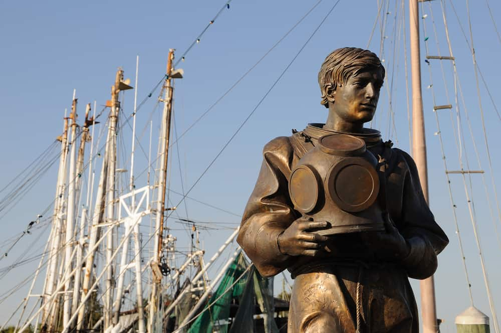 historic statue of a diver in tarpon springs florida