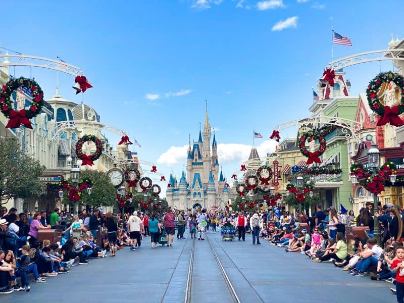 Wreaths line the path to Cinderella's Castle at Disney World in Orlando, during Christmas in Florida.