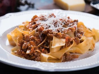 Photo of pasta with a Bolognese sauce.